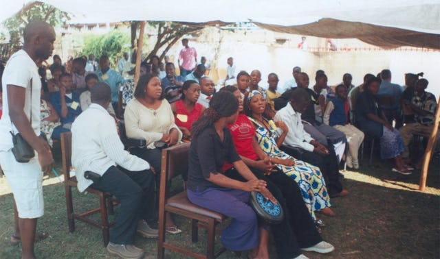 Conference participants join in a discussion during a plenary session.