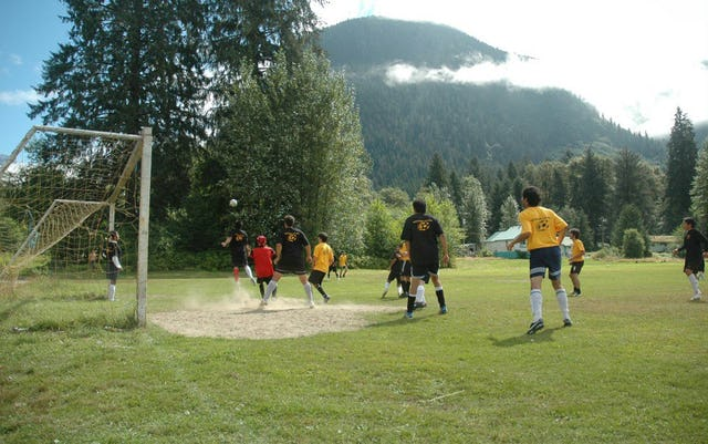Soccer played in classic Musgamagw Cup style.