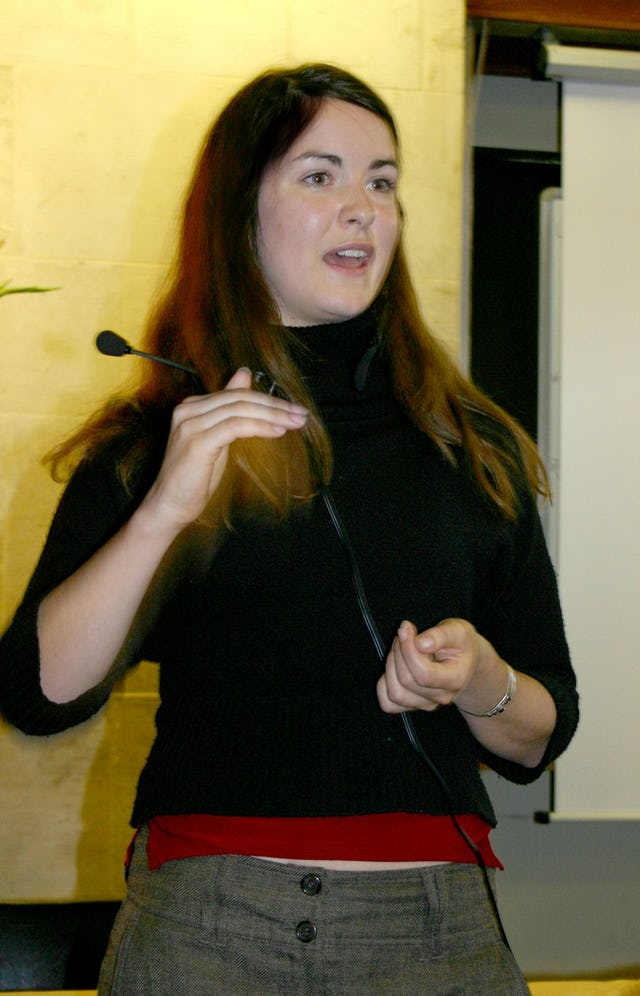 """Poppy Villiers-Stuart, a training officer specializing in sustainable development at the University of Brighton, gives a presentation about community empowerment at the """"Science, Faith and Climate Change"""" at Oxford, 15-17 September 2006. (Photograph by Gemma Parsons)"""