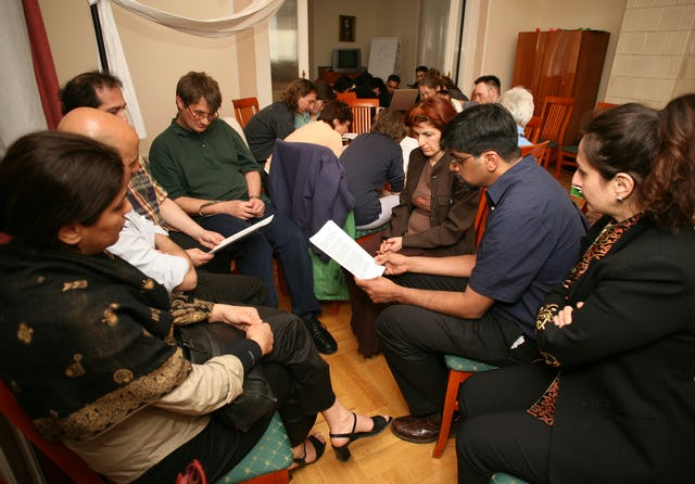 In Budapest, Hungary, people break into small groups to study a message from the Universal House of Justice about the nature of Baha'i elections. Participants then elected their local governing council for the coming year. (Photograph by Edit Kalman)