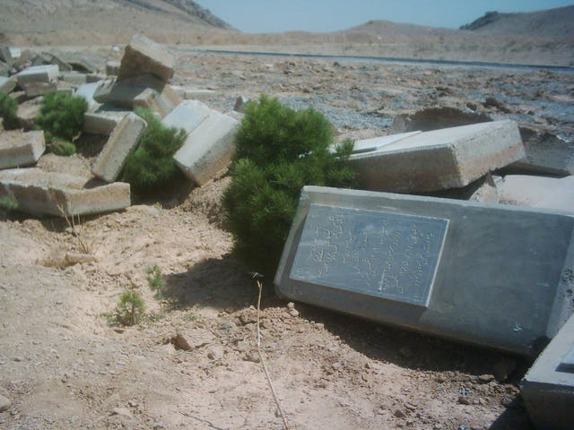 Gravestones in the Baha'i cemetery near Najafabad, Iran, were left in a heap by a bulldozer that destroyed the burial ground some time between 9 September and 10 September 2007.