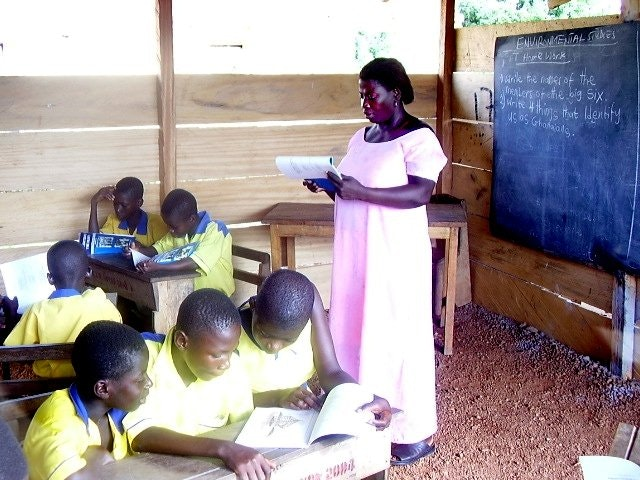 Teacher Victoria Kwofie leads students in their work at the Anyinabrim primary school.