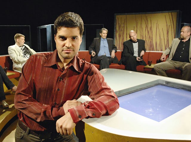 Aram Aflatuni, seen here on the set of his late night prime time show, has been working on television for 11 years.