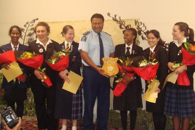 In Auckland, New Zealand, a representative of the New Zealand Police presents the winner's shield for the 2008 Race Unity Speech Award to Charon Maseka of Wellington. With them are the other finalists for the award.