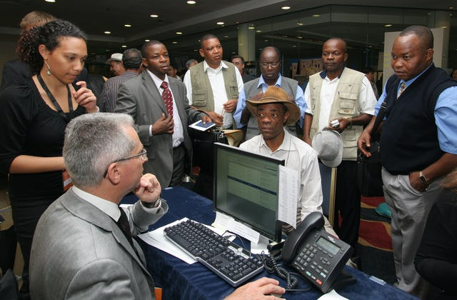 Members of the National Spiritual Assembly of the Democratic Republic of the Congo register on 26 April for the International Baha'i Convention in Haifa, Israel.