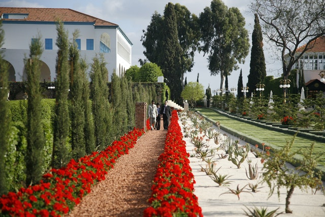 At Bahji near Acre are the home, left, where Baha'u'llah lived His final years and the Shrine, at right, where His earthly remains are buried. Those attending the International Convention went there for personal prayer upon arrival in the Holy Land.