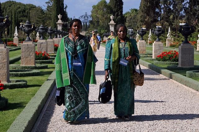 Delegates from Cameroon walk toward the Shrine of Baha'u'llah at Bahji, near Acre.