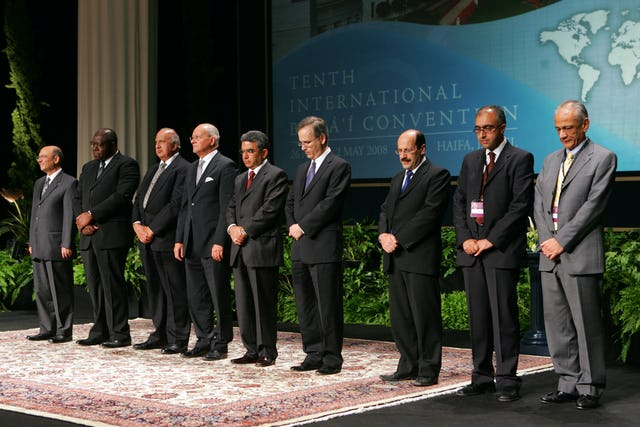 The members of the Universal House of Justice are, from left to right, Farzam Arbab, Kiser Barnes, Peter Khan, Hooper Dunbar, Firaydoun Javaheri, Paul Lample, Payman Mohajer, Shahriar Razavi, and Gustavo Correa. They were elected by delegates to the 10th International Baha'i Convention in Haifa. Election results were announced on 30 April.