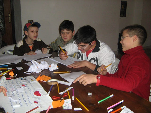 Through discussion, service projects, the arts, and games, the classes in Portici help young people learn respect for themselves and others and how to serve the community.