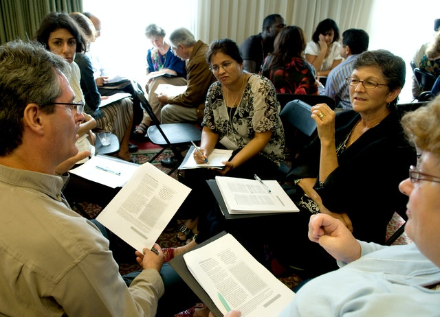 Participants at the 32nd annual conference of the North American Association for Baha'i Studies meet in a break-out sesssion. The conference was held in San Diego.