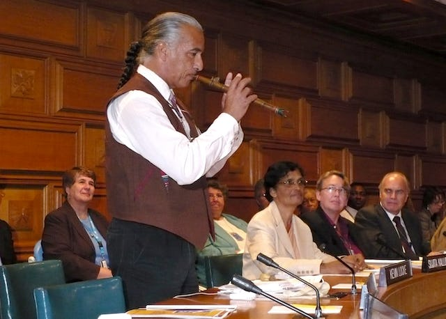 Kevin Locke plays flute at a UN roundtable on the International Day for the Eradication of Poverty. He opened the roundtable with a prayer recited in his native Lakota Sioux dialect. The event was at the United Nations in New York on 17 October 2008.