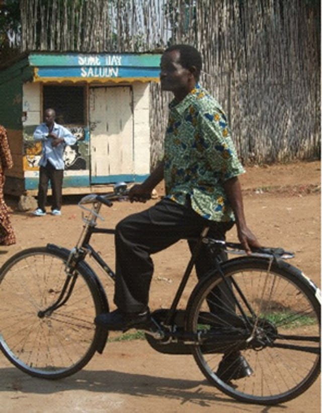Hizzaya Hissani, UPLIFT program director, uses a bicycle to travel from village to village to monitor the program and consult with participants.