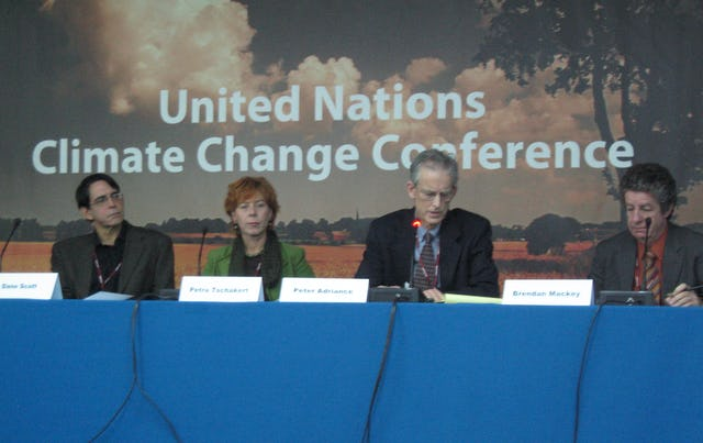 """Baha'i representative Peter Adriance, second from right, speaks during a panel discussion on """"Moral and ethical issues that must be faced in implementing the Bali roadmap."""" Others, from left, are Dane Scott of the University of Montana at Missoula, Petra Tschakert of Penn State University, and Brendan Mackey of the Australian National University."""