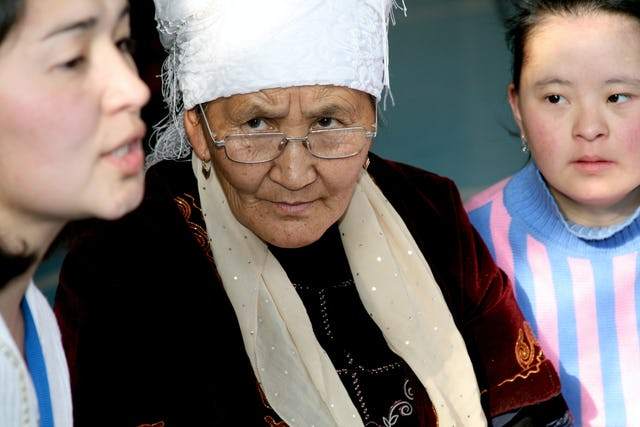 A participant from Kyrgyzstan, center, listens intently as a young woman from Kazakhstan speaks during a workshop at the conference in Almaty on the weekend of 6-7 December.
