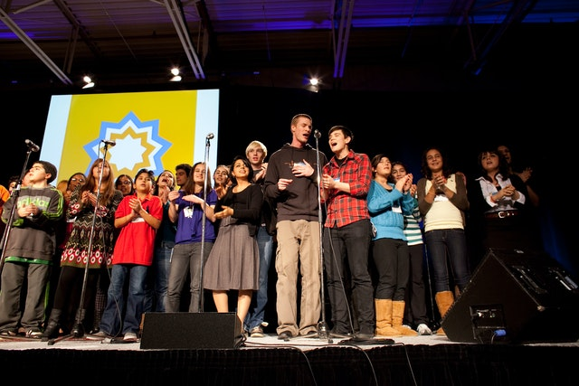 Young people join for a presentation at the conference in Toronto, which with 4,000 people was one of the largest gatherings in the current series.