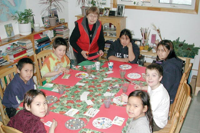 In this file photo from the Nunatsiaq News, Beth McKenty prepares materials for youngsters in Iqaluit who come her sessions to create art. (Photo copyright 2002 Nunatsiaq News. Used by permission.)