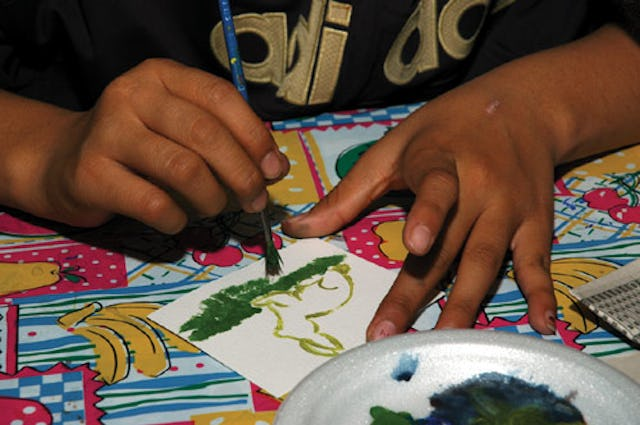 """The young people are offered space and materials for their work, but Beth McKenty says she """"never really instructed these children."""" (Photo copyright 2004 Nunatsiaq News. Used with permission.)"""