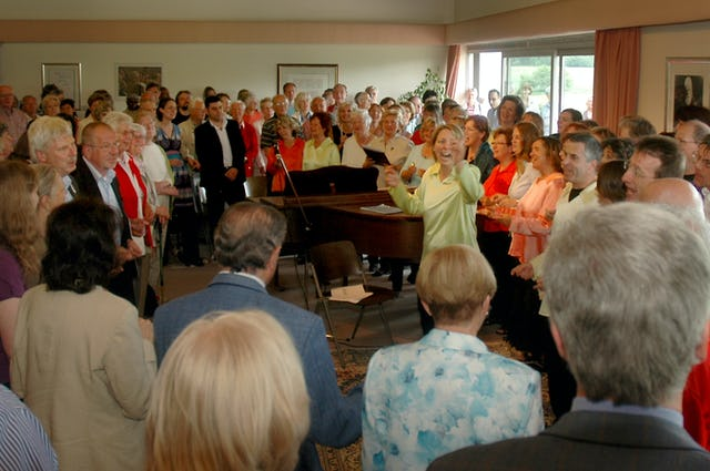 After the devotional at the Baha'i House of Worship in Langenhain, singers walked to the nearby Baha'i center for a second program (shown here) where both the Langenhain and Baha'i choirs again performed for the townspeople.