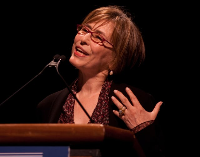 """Azar Nafisi, author of """"Reading Lolita in Tehran,"""" addresses an audience in Washington on the treatment of minorities in Iran. (Photo by Evan Wilder)"""