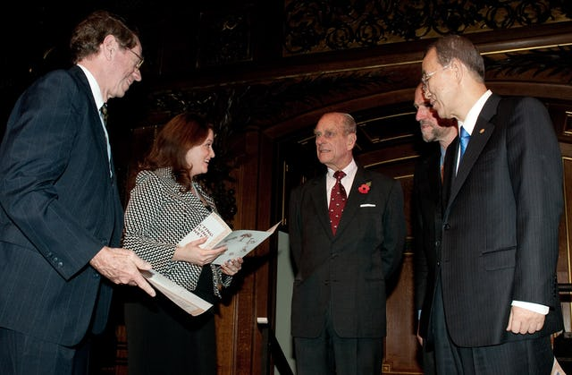Baha'i delegates Arthur Lyon Dahl and Tahirih Naylor receive certificates at the Windsor Castle gathering. They are pictured with Prince Philip, founder of ARC; Martin Palmer of ARC; and UN Secretary General Ban Ki-moon.