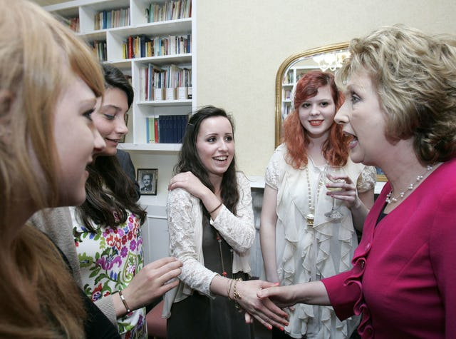 During her visit, President McAleese, right, spoke with young Baha'is from the Dublin area