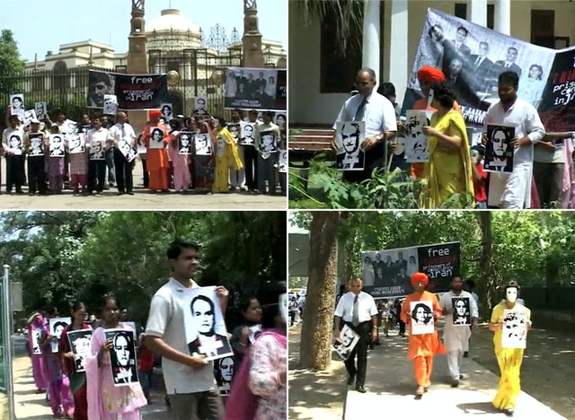 Images of the seven imprisoned Baha'i leaders featured prominently in the United4Iran march through the streets of New Delhi. Photographs taken from video footage.