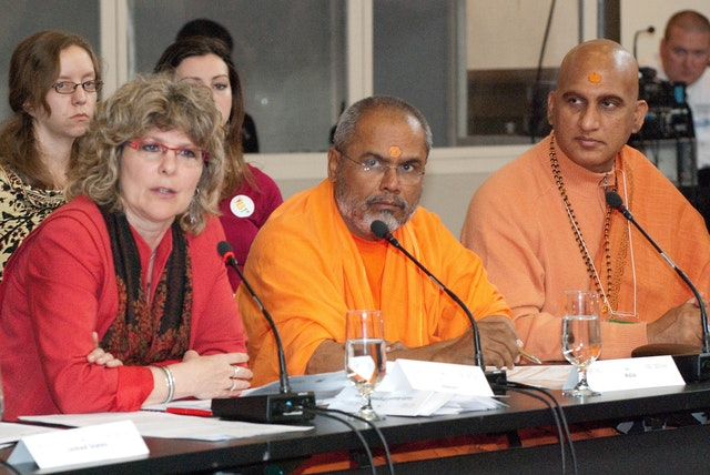Delegates to the 2010 World Religions Summit attended from more than 20 countries. Seated left to right are: the Rev. Dr. Karen A. Hamilton, general secretary of the Canadian Council of Churches; H.H. Swami Paramatmananda Saraswati and Swami Avdheshanand Giri, of the Hindu Dharma Acharya Sabha. Photograph by Louis Brunet.