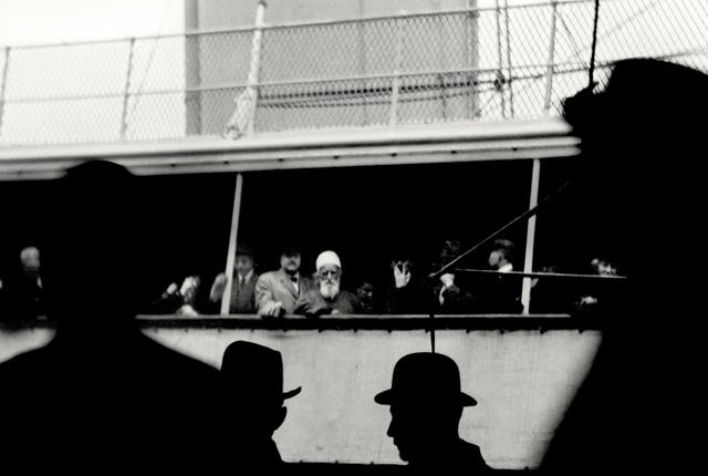 """'Abdu'l-Baha glimpsed on board the S.S. Celtic as He sailed away from New York City bound for Liverpool, England, 5 December 1912. His parting words expressed the wish """"that the East and West may embrace each other in love and deal with one another in sympathy and affection. Until man reaches this high station, the world of humanity shall not find rest..."""""""