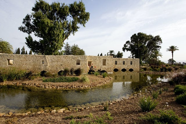 Some of the 15 flour mills that once operated in parallel at the southern end of the Ridvan Garden have also been restored. This view shows the mill buildings, and some newly-created island features in the water.