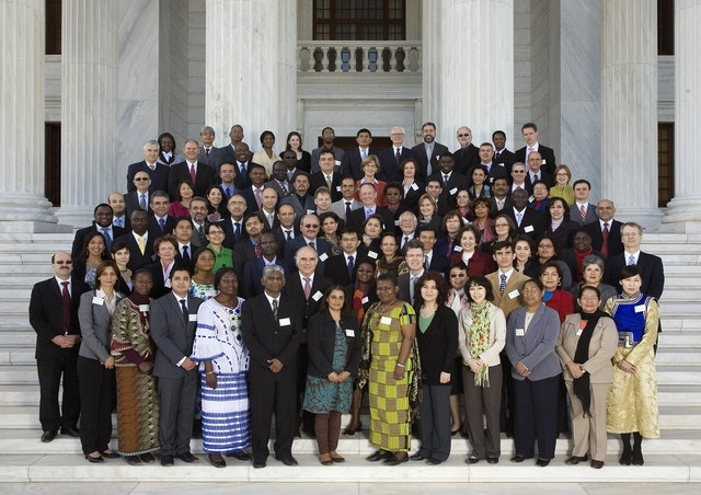 Members of the Continental Boards of Counsellors - gathered on the steps of the Seat of the Universal House of Justice - with members of the Universal House of Justice and the International Teaching Centre. The five Continental Boards of Counsellors have the responsibility of educating, encouraging, and stimulating the development of Baha'i communities throughout the world. The photograph was taken on the first day of their conference, 28 December 2010.