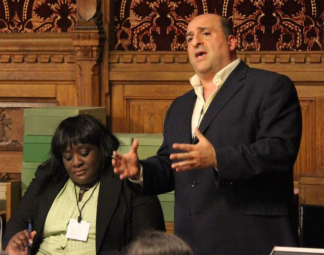 Omid Djalili, actor and comedian, addresses a seminar on human rights in Iran held at the United Kingdom's Houses of Parliament on 15 June. Mr. Djalili praised the fortitude and perseverance of the Iranian Baha'i community. Seated beside him is Khataza Gondwe of Christian Solidarity Worldwide.