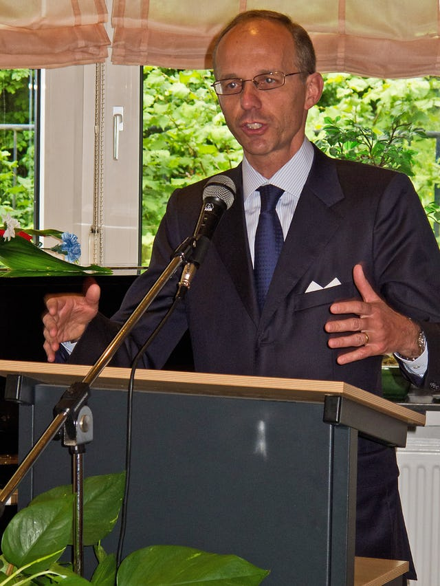 Luxembourg's Minister of Finance, Luc Frieden, addressing a celebration marking National Day at the Baha'i Centre in Luxembourg City.