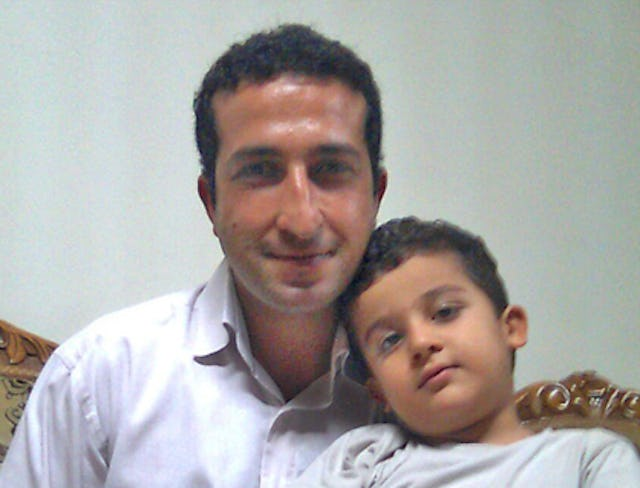 Pastor Youcef Nadarkhani, pictured with his younger son. Photo credit: Christian Solidarity Worldwide.
