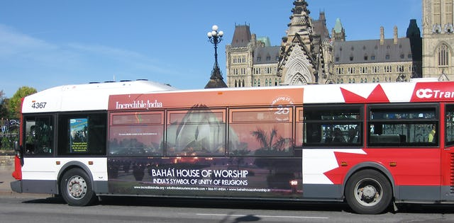 """A poster of the Baha'i House of Worship in New Delhi depicted on the side of a bus in Ottawa, Canada, as part of the Indian government's global """"Incredible India"""" campaign."""