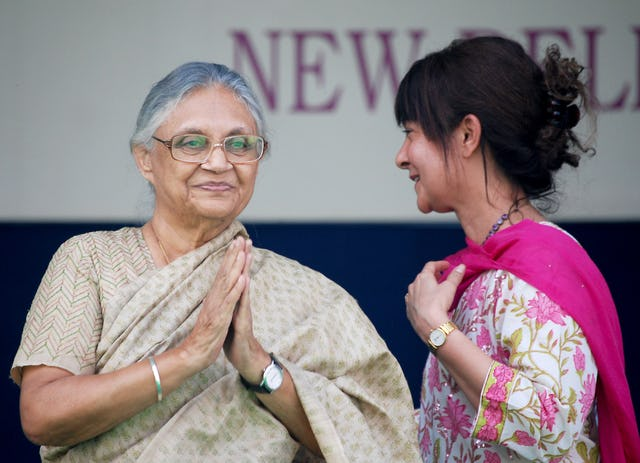 The Chief Minister of Delhi, Mrs. Sheila Dikshit – pictured left – greets the more than 5,000 visitors assembled for the 25th anniversary celebrations of the Baha'i House of Worship, 11-12 November 2011. She is welcomed to the stage by Naznene Rowhani, Secretary of the National Spiritual Assembly of the Baha'is of India.