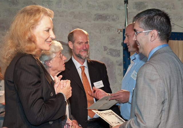 Jalal Hatami, Deputy Secretary-General of the Baha'i International Community – pictured right – speaks with Her Royal Highness Princess Michael of Kent at the launch of the Green Pilgrimage Network. Behind them, from left to right, are Sara Morrison, Vice President Emeritus of WWF International; Alliance of Religions and Conservation Secretary-General Martin Palmer; and Danny Ronen, general manager of Haifa Tourist Board. Photograph: ARC/Katia Marsh.
