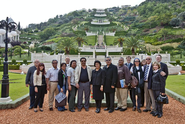 The president of the Republic of Palau, Mr. Johnson Toribiong, and his wife, Mrs. Valeria Toribiong – pictured center – are shown visiting the terraces of the Shrine of the Bab, Haifa, Israel, on Friday 25 November. Guests also included representatives of the municipality of Haifa.