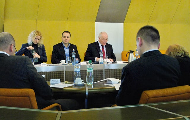 "Members of the Foreign Affairs Committee of the National Council of the Slovak Republic met on 19 January to discuss a resolution condemning the Iranian regime's persecution of Baha'is. The Committee's chair, Dr. Frantisek Sebej, pictured center with red tie, said, ""Though I do not expect that the Iranian Government will stop the persecution of Baha'is, at least it will not dare to do more horrific things while thinking that no one is watching and nobody cares."""