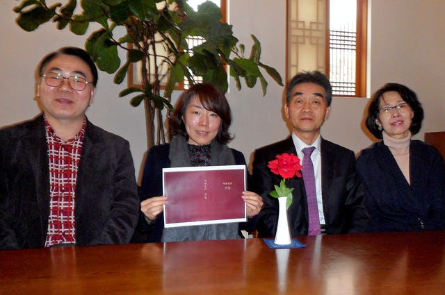 """Among the Baha'is overseeing the publication of """"Gleanings from the Writings of Baha'u'llah"""" in Korean are, pictured from left to right, Won Pill Jung, So Jeong Park, Young Kyung Kim and Hee Jin Koo."""