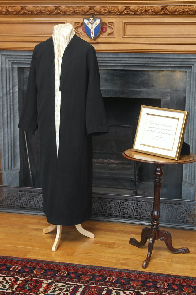 "A robe worn by 'Abdu'l-Baha and a framed calligraphic rendering of words from His first ever public speech, delivered on 10 September 1911 at London's City Temple: ""The gift of God to this enlightened age is the knowledge of the oneness of mankind and of the fundamental oneness of religion."" The historic items were exhibited at a reception held at Lambeth Palace to mark the Diamond Jubilee of Her Majesty Queen Elizabeth II."