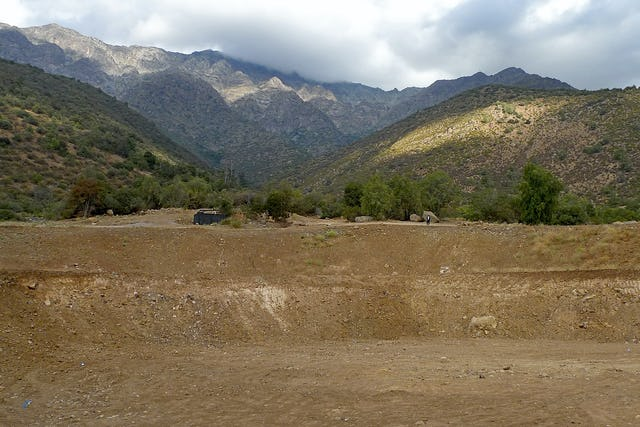 The beautiful location of the site of the Baha'i House of Worship for Chile, in the hills of Peñalolén, Santiago, at the foot of the Andes. In the foreground can be seen the excavation and grading work for the House of Worship's foundation and plaza which has been completed ahead of schedule.