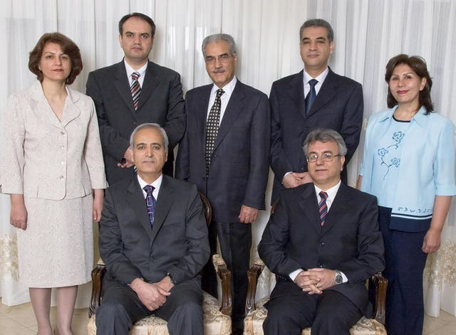 The seven Baha'i prisoners – photographed several months before their arrest – are (front) Behrouz Tavakkoli and Saeid Rezaie; and (standing) Fariba Kamalabadi, Vahid Tizfahm, Jamaloddin Khanjani, Afif Naeimi, and Mahvash Sabet.