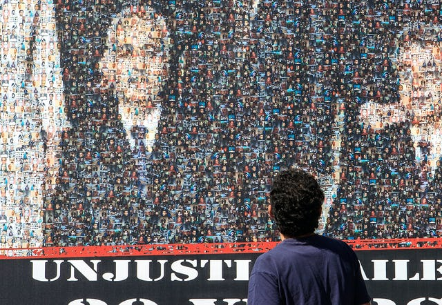 The mobile billboard image of the Baha'i leaders seen around the world was a mosaic of smaller photographs of hundreds of people currently jailed in Iran including journalists, trade unionists, politicians, student and women's activists, and religious leaders.