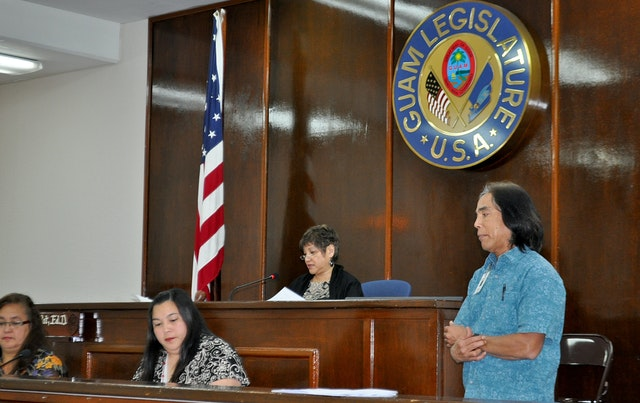 Speaker Judith Won Pat – pictured center – addresses the Guam legislature during a vote about the denial of access to higher education in Iran. The vote, which passed by a majority of 14-0, was held on 27 April 2012.
