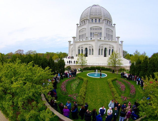 Visitors gather at the Baha'i House of Worship in Wilmette, Illinois, for a special commemorative program held on 29 April 2012, marking the centenary of 'Abdu'l Baha's laying of the building's cornerstone. Three services included prayers read by children in several languages, selections of sacred writings sung by the Temple's choir, and the rare opportunity for visitors to hear a recording of 'Abdu'l-Baha's own voice.