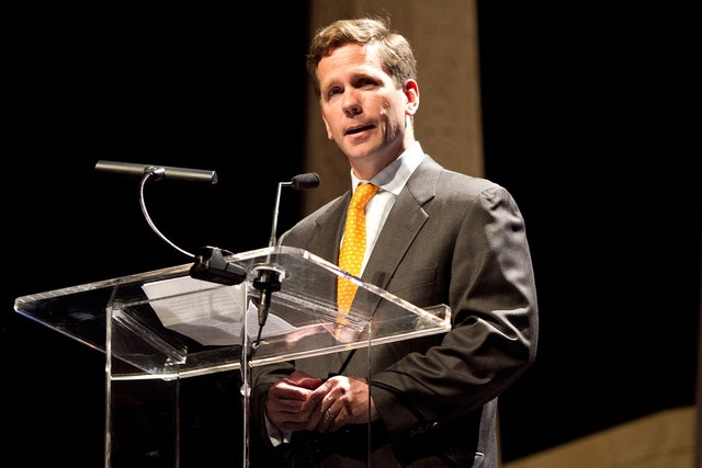 Illinois Congressman Robert Dold addressed the audience at the Chicago Theatre on 28 April 2012, acknowledging Baha'i efforts to build a more unified society.