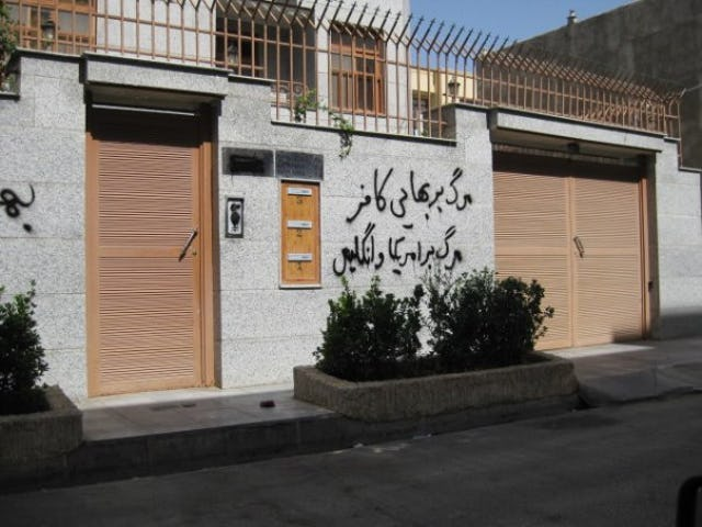 "A home in Semnan sprayed with offensive graffiti which, when translated into English, reads: ""Down with the pagan Baha'i. Down with America and Britain."""