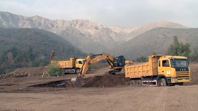 """An image from the video newsreel, """"Progress on the Construction of the Baha'i House of Worship for South America,"""" which depicts excavation work commencing in the hills of Peñalolén, Santiago, Chile, at the foot of the Andes. The video is now available for viewing online."""
