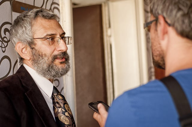 Dr. Grigorij Mesežnikov, president of the Institute for Public Affairs – pictured left – is interviewed at a press conference, held in Bratislava, 17 September 2012, which launched an open letter from 84 Slovak academics calling for an end to the persecution of Baha'i educators and students in Iran.
