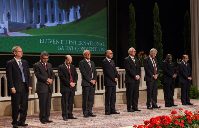 The members of the Universal House of Justice are, from left to right, Paul Lample, Firaydoun Javaheri, Payman Mohajer, Gustavo Correa, Shahriar Razavi, Stephen Birkland, Stephen Hall, Chuungu Malitonga, and Ayman Rouhani. They were elected by delegates to the 11th International Baha'i Convention in Haifa.